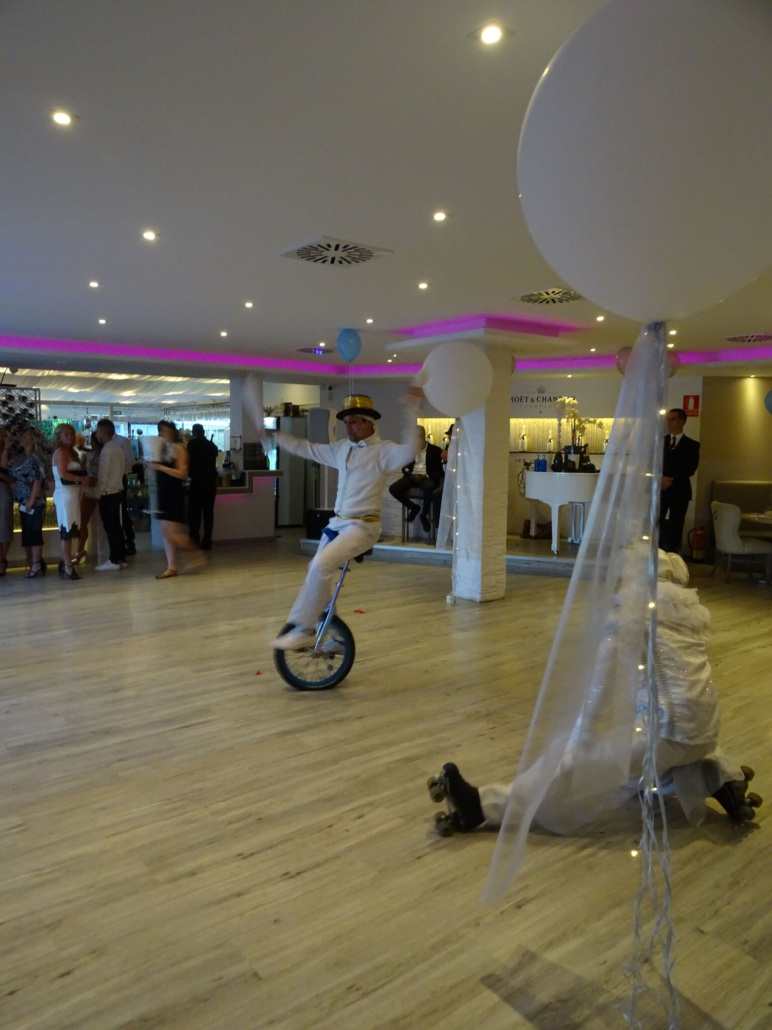 White outfit. Unicycle